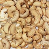 Cashew nuts original background. Cashew nuts on a dark background Stock Photos