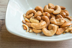 Cashew nuts on the plate. As appetizer Stock Photography