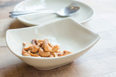 Cashew nuts on the plate. With catering sets Stock Photos