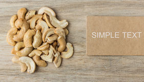 Cashew nuts and price tag on wooden Royalty Free Stock Images