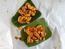 Cashew nuts sprinkle syrup on the green leaf. stock images