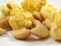 Cashew nuts & toffee popcorn. A mixture of toffee popcorn and cashew nuts (salted Stock Images