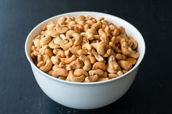 Cashew nuts in white bowl.  Stock Photos