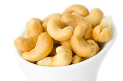 Cashew nuts in a white bowl. Stock Photo