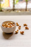 Cashew nuts on wooden background Stock Images