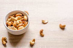 Cashew nuts on wooden background Royalty Free Stock Photos