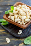 Cashew nuts in a wooden bowl. Royalty Free Stock Images