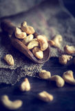 Cashew nuts. In wooden scoop,selective focus royalty free stock image