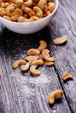 Cashew nuts on wooden table. Royalty Free Stock Image