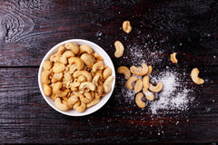 Cashew nuts on wooden table. Royalty Free Stock Photo