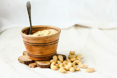 Cashew sauce for salad, raw vegan cheese from nuts with nutritional yeast. Cashew sauce, raw vegan cheese from nuts with nutritional yeast. Dairy free. Healthy royalty free stock photography