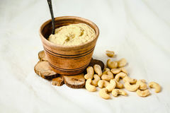 Cashew sauce for salad, raw vegan cheese from nuts with nutritional yeast. Cashew sauce, raw vegan cheese from nuts with nutritional yeast. Dairy free. Healthy royalty free stock photos