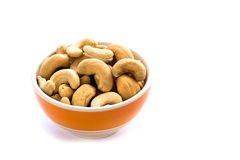 Cashews in the bowl on white background Royalty Free Stock Photography
