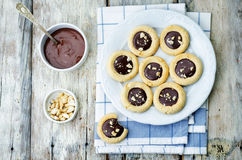 Cashews butter cookies with cashews and chocolate frosting Royalty Free Stock Images