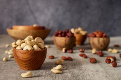 Cashew in a bowl on a dark wooden background. stock image