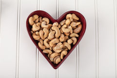 Cashews in Heart Bowl above view Stock Image