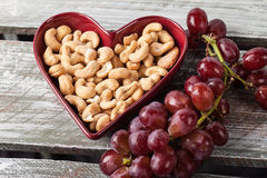 Cashews in Heart Bowl angled shot Stock Photos