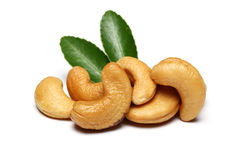 Cashews and leaves royalty free stock images