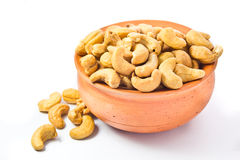 Cashews nut. In bowl on white background royalty free stock photos
