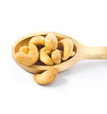 Cashews nut. In wooden spoon on white background royalty free stock images