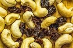 Cashews and Raisins on a wooden Cutting Board. Studio shot Royalty Free Stock Photography