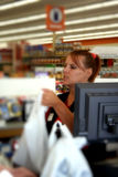 Cashier. Photo taken of a cashier checking out a customer Stock Image