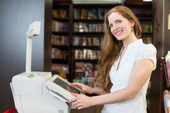 Cashier at cash register in bookstore Stock Images