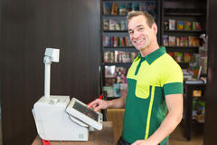 Cashier at cash register in shop or store Royalty Free Stock Photography