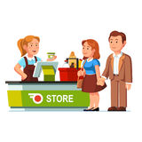 Cashier at checkout counter and serving customers. Cashier girl working ringing food goods at checkout counter and serving customers at grocery store or Stock Photo