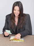Cashier counting euros Royalty Free Stock Photo