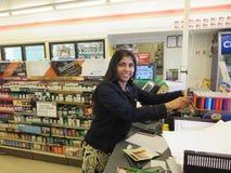 Cashier girl inside store stock image