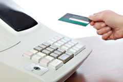 Cashier Holding Credit Card in Cash Register Royalty Free Stock Image