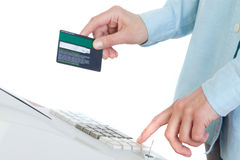 Cashier Holding Credit Card in Cash Register Royalty Free Stock Photos