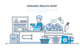 Cashier lays the goods on showcase, sells natural, organic products. Royalty Free Stock Images