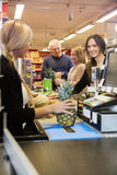 Cashier Making Bills At Checkout Counter Stock Images