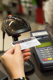 Cashier's hand scanning barcode on member card with credit card Royalty Free Stock Image