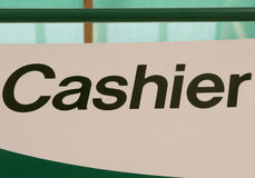 Cashier sign indoors, indicating location to pay Stock Image