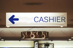 Cashier sign at shopping mall. Close-up stock images