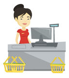 Cashier standing at the checkout in supermarket. Stock Images