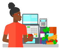 Cashier at supermarket checkout. A cashier at supermarket counter vector flat design illustration isolated on white background Royalty Free Stock Images