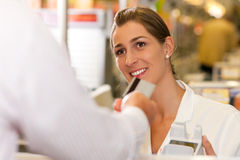 Cashier in supermarket taking credit card royalty free stock images