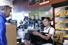 Cashier takes order Royalty Free Stock Photos