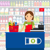 Cashier woman in supermarket Stock Photo