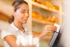 Cashier at work. Royalty Free Stock Photography