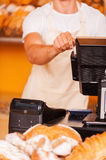 Cashier at work. Royalty Free Stock Photo
