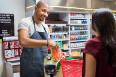 Free Cashier Working At Supermarket Royalty Free Stock Photo - 94502335
