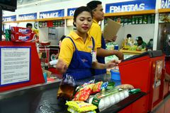 Free Cashiers And Bagger Boys In A Grocery Store In The Philippines Stock Photography - 53988162