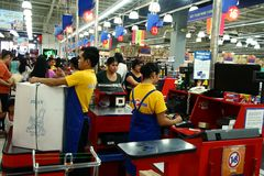Cashiers and bagger boys in a grocery store in the philippines Royalty Free Stock Images