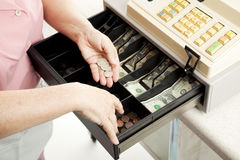 Cashiers Hands Make Change Royalty Free Stock Images