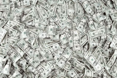 Cashing. Close up view of cash money dollars bills in amount Royalty Free Stock Image